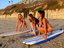 Girls learning to surf at Wavehuggers